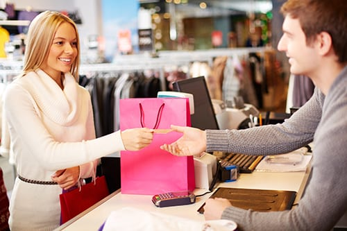Department store clerk and customer