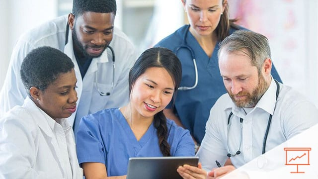 Healthcare workers gathered around a tablet