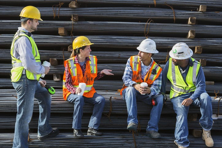 Construction workers chat while on a break at work